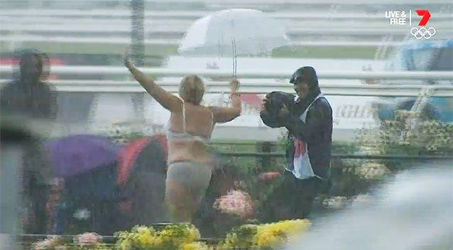 A happy streaker brightened a dreary Melbourne day at Flemington. Photo: 7 Sport