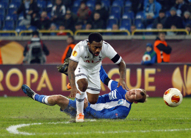 Tottenham's Danny Rose, top, challenges for the ball against Roman Zozulya of Ukrainian Dnipro, during their Europa League round of 32, first leg soccer match at GSP Stadium in Dnipropetrovsk, Ukraine, Thursday, Feb. 20, 2014. (AP Photo/Sergei Kozin)