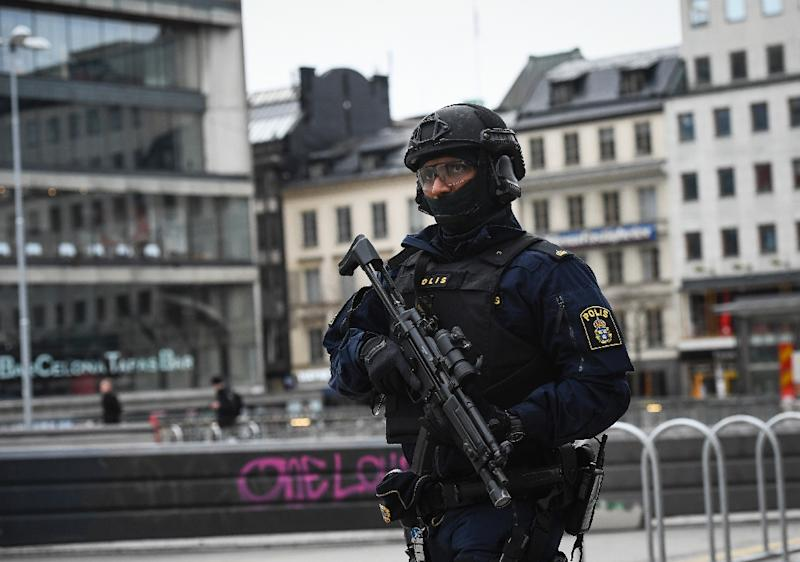 An armed police officer patrols in Stockholm following a deadly truck attack in April 2017