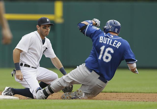 Kansas City Royals designated hitter Billy Butler beats the tag of Detroit Tigers second baseman Ian Kinsler for a double during the sixth inning of a baseball game in Detroit, Thursday, June 19, 2014. (AP Photo/Carlos Osorio)