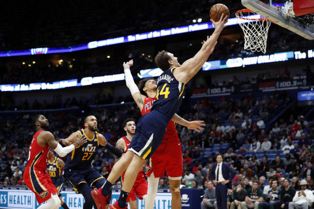 Utah Jazz forward Bojan Bogdanovic (44) drives to the basket in front of New Orleans Pelicans center Jaxson Hayes in the second half of an NBA basketball game in New Orleans, Monday, Jan. 6, 2020. (AP Photo/Tyler Kaufman)