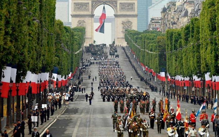 French soldiers parade during the Bastille Day military parade down the Champs-Elysees avenue in Paris - AFP