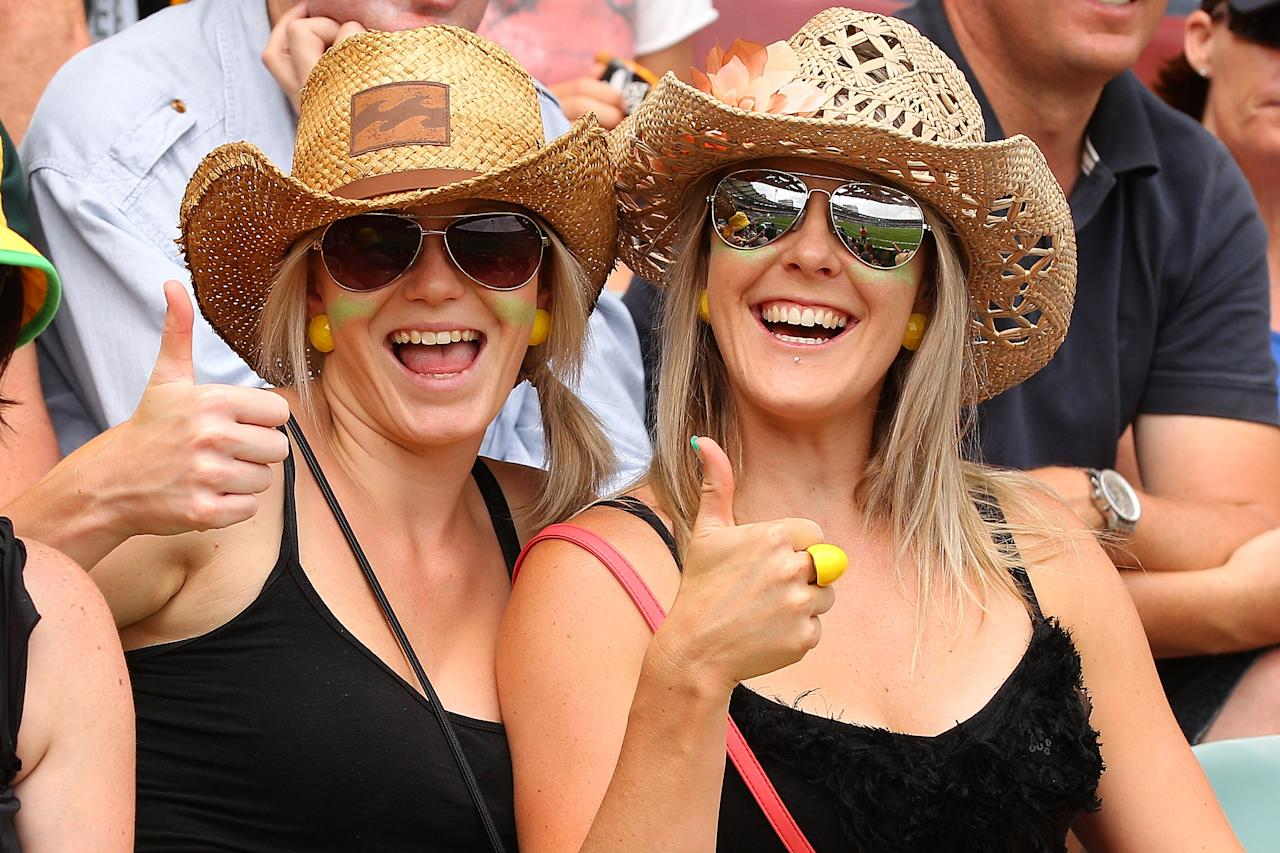 BRISBANE, AUSTRALIA - NOVEMBER 09:  Fans cheer during day one of the First Test match between Australia and South Africa at The Gabba on November 9, 2012 in Brisbane, Australia.  (Photo by Chris Hyde/Getty Images)