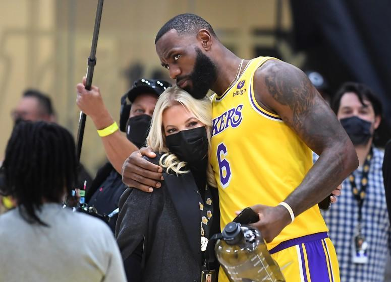 El Segundo, CA. September 28, 2021: Lakers LeBron James hugs owner Jeannie Buss during media day at the UCLA Health Training Center in El Segundo Tuesday. (Wally Skalij/Los Angeles Times)
