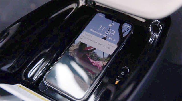 Why don't all cars have Qi wireless phone charging pads built-in?