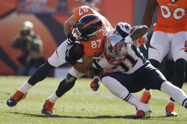 Denver Broncos wide receiver Eric Decker (87) is stopped New England Patriots cornerback Aqib Talib (31) during the first half of the AFC Championship NFL playoff football game in Denver, Sunday, Jan. 19, 2014. (AP Photo/Charlie Riedel)