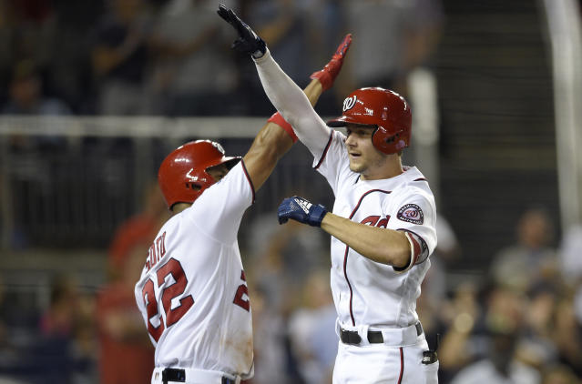 Washington Nationals' Trea Turner, right, celebrates his grand slam with Juan Soto during the sixth inning of a baseball game against the Miami Marlins, Thursday, July 5, 2018, in Washington. The Nationals won 14-12. (AP Photo/Nick Wass)