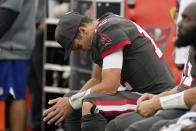 Tampa Bay Buccaneers quarterback Tom Brady looks down as he sits on the bench during the second half of an NFL football game against the Los Angeles Rams Sunday, Sept. 26, 2021, in Inglewood, Calif. (AP Photo/Jae C. Hong)