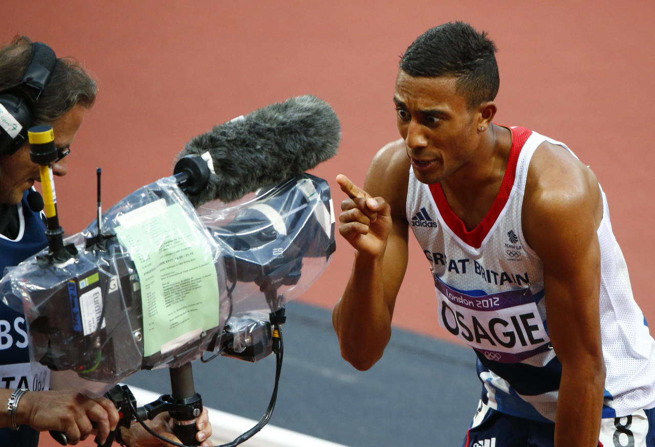 Britain's Andrew Osagie reacts in front of a television camera after his second place finish in his men's 800m semi-final during the London 2012 Olympic Games at the Olympic Stadium August 7, 2012. REUTERS/David Gray (BRITAIN  - Tags: OLYMPICS SPORT ATHLETICS MEDIA)