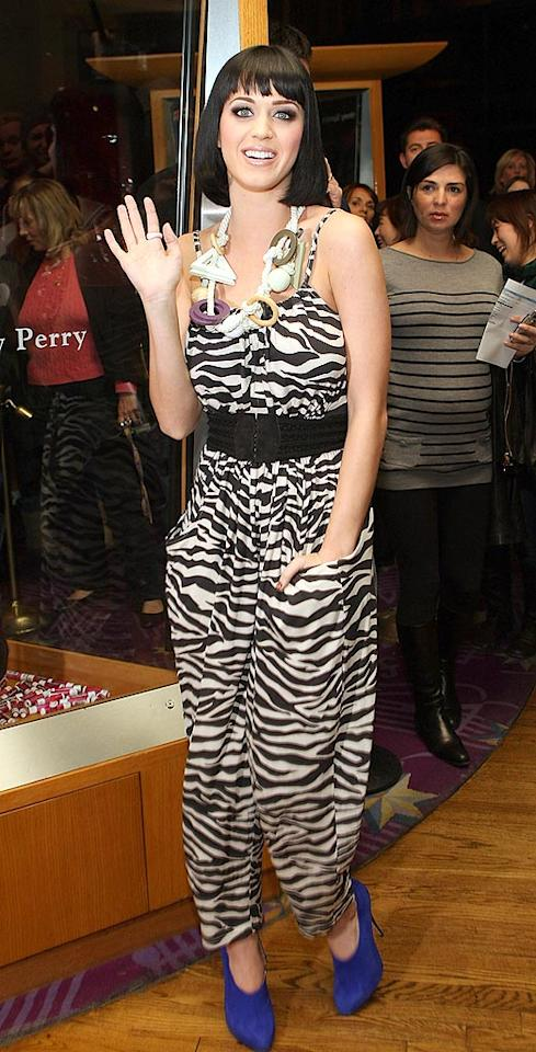 "Katy Perry strikes again in a putrid zebra-print jumpsuit and hideous blue heels. Isaac Brekken/<a href=""http://www.gettyimages.com/"" target=""new"">GettyImages.com</a> - February 14, 2009"