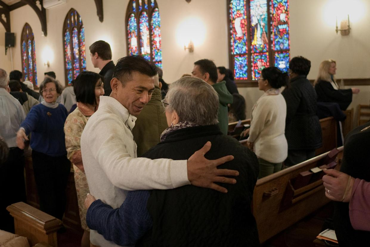 Harry Pangemanan with fellow congregants at the Reformed Church of Highland Park (N.J.). (Photo: Alan Chin for Yahoo News)