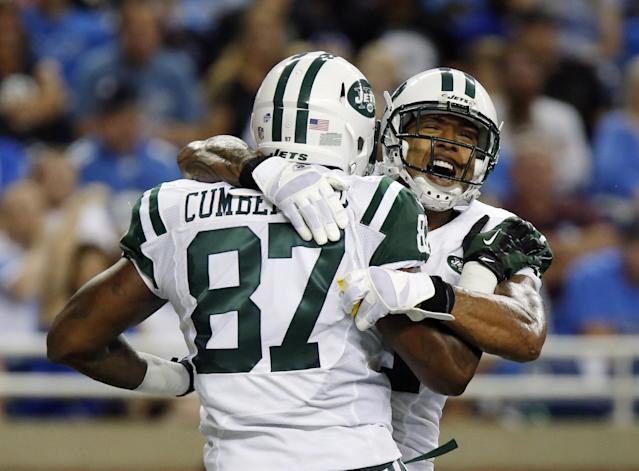 New York Jets tight end Jeff Cumberland (87) celebrates his 26-yard touchdown reception with teammate tight end Kellen Winslow during the first quarter of a preseason NFL football game against the Detroit Lions at Ford Field in Detroit, Friday, Aug. 9, 2013. (AP Photo/Duane Burleson)