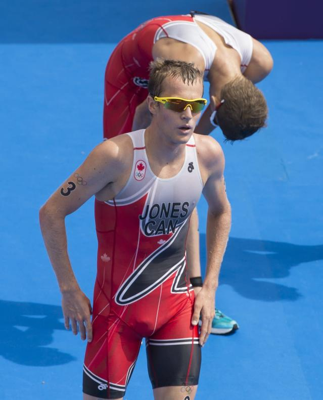 Canada's Kyle Jones, front and Brent McMahon complete the men's triathlon at the 2012 London Olympics, August 7, 2012. Jones placed 25th and McMahon 27th. THE CANADIAN PRESS/HO, COC - Jason Ransom