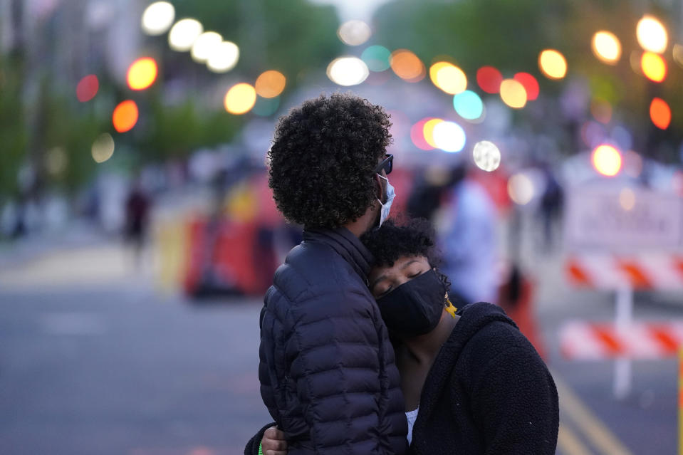 A couple dances at Black Lives Matter Plaza near the White House on Tuesday, April 20, 2021, in Washington, after the verdict in Minneapolis, in the murder trial against former Minneapolis police officer Derek Chauvin was announced. (AP Photo/Alex Brandon)