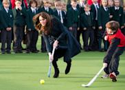 <p>The high school field hockey player picked the stick up again for St Andrew's Day at St Andrew's School (Kate's alma mater). For the occasion, she wore a navy and green plaid coat and heeled black boots. </p>