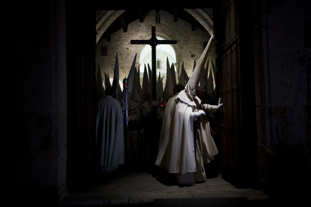 <p>Penitents of the Jesús Yacente brotherhood take part in a Holy Week procession in Zamora, Spain, March 28, 2013. (Photo: Daniel Ochoa de Olza/AP) </p>