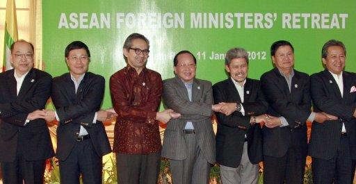 """This file photo shows ASEAN foreign ministers posing for a picture during their previous official gathering in Siem Reap, Cambodia, in January. Southeast Asian and European foreign ministers began meeting in Brunei on Friday to chart a """"new chapter"""" in their relations now that democratic reforms are under way in former pariah Myanmar"""