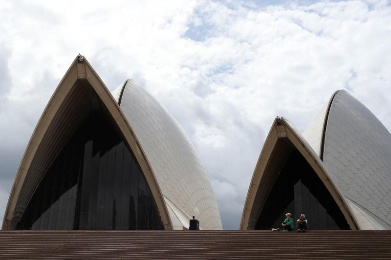 NPeople are seen on the nearly deserted steps of the Sydney Opera House