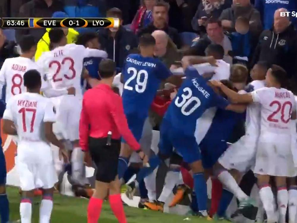 Everton and Lyon fans brawl while a fan tries to hit a player while holding his son (BT Sport)