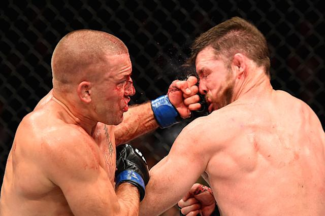 <p>Georges St-Pierre of Canada lands a punch to take down Michael Bisping of England in their UFC middleweight championship bout during the UFC 217 event at Madison Square Garden on November 4, 2017 in New York City. (Photo by Josh Hedges/Zuffa LLC/Zuffa LLC via Getty Images) </p>