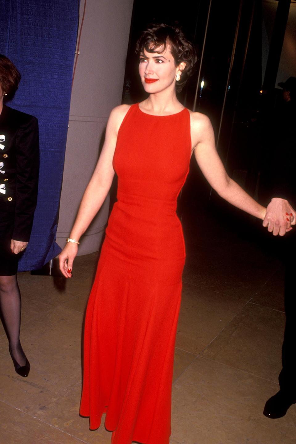 """<strong><h2>1993</h2></strong><br>In a sea of little black dresses and sequin shoulder pads, Janine Turner shines in this red, fitted gown.<br><br><em>Janine Turner in a red dress.</em><span class=""""copyright"""">Photo: Ron Galella, Ltd/WireImage.</span>"""