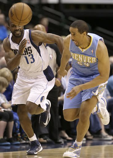 Denver Nuggets point guard Andre Miller (24) and Dallas Mavericks point guard Mike James (13) chase the loose ball during the first half of an NBA basketball game on Friday, April 12, 2013, in Dallas. (AP Photo/LM Otero)