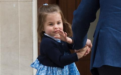Princess Charlotte waves to the cameras outside the Lindo Wing - Credit: Anwar Hussein