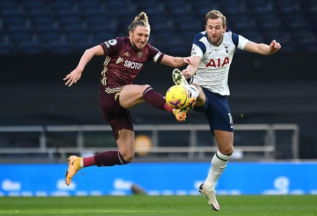 Luke Ayling, left, battles for possession with Tottenham's Harry Kane