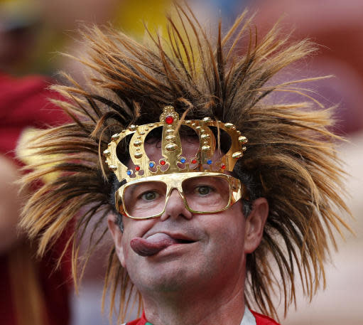 A Portugal's fan sticks his tongue out as he sits in the stands prior to the group B match between Portugal and Morocco at the 2018 soccer World Cup in the Luzhniki Stadium in Moscow, Russia, Wednesday, June 20, 2018. (AP Photo/Francisco Seco)