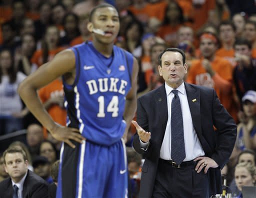 Duke guard Rasheed Sulaimon (14) watches as a Virginia player makes the shot after a technical foul on Sulaimon, as Duke coach Mike Krzyzewski reacts during the second half of an NCAA college basketball game in Charlottesville, Va., Thursday, Feb. 28, 2013. Virginia won 73-68. (AP Photo/Steve Helber)