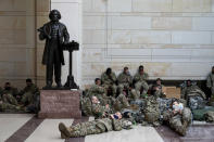 Troops hold inside the Capitol Visitor's Center to reinforce security at the Capitol in Washington, Wednesday, Jan. 13, 2021. The House of Representatives is pursuing an article of impeachment against President Donald Trump for his role in inciting an angry mob to storm the Capitol last week.. (AP Photo/Alex Brandon)