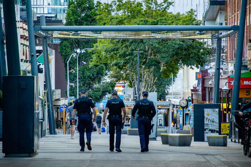 Police officers patrol the Valley Mall in Brisbane as more than two million people in the city entered a three-day lockdown after a cluster of coronavirus cases was detected in Australia's third-biggest city.