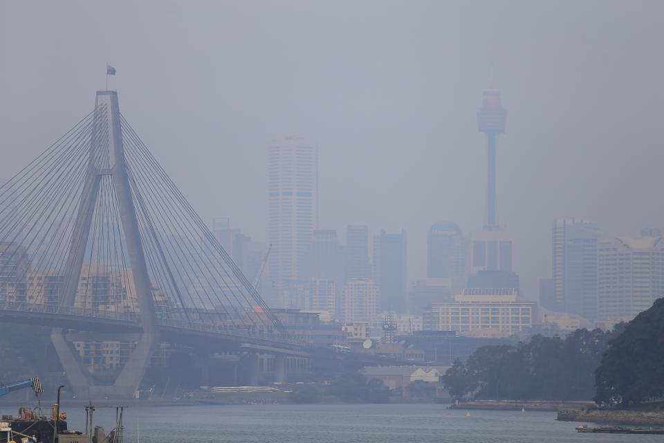 Air quality readings in parts of NSW has reached hazardous levels as extensive smoke haze from fires in the state's north is pushed over Sydney. Source: AAP Image/Steven Saphore.