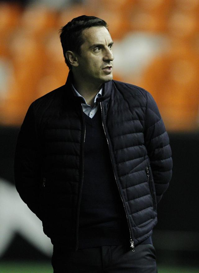 Valencia's British coach Gary Neville waits on the sideline before the Spanish league football match Valencia CF vs Real Madrid CF at the Mestalla stadium in Valencia on January 3, 2016. AFP PHOTO/ JOSE JORDAN (AFP Photo/JOSE JORDAN)