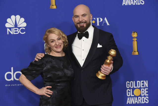 "Arianne Sutner, left, and Chris Butler pose in the press room with the award for best animated motion picture for ""Missing Link"" at the 77th annual Golden Globe Awards at the Beverly Hilton Hotel on Sunday, Jan. 5, 2020, in Beverly Hills, Calif. (AP Photo/Chris Pizzello)"
