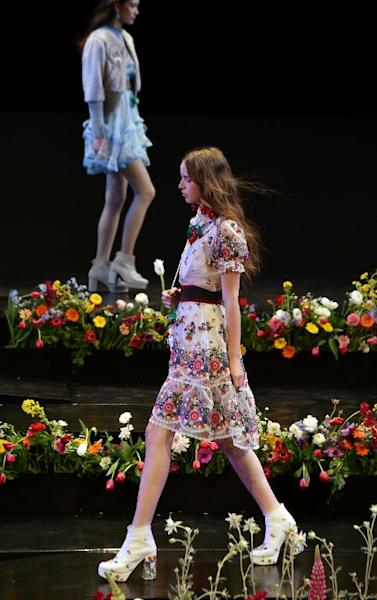 A model displays a creation from Thai designer Pim Sukhahuta's Sretsis 2015-16 autumn/winter collection during the opening of Tokyo Fashion Week
