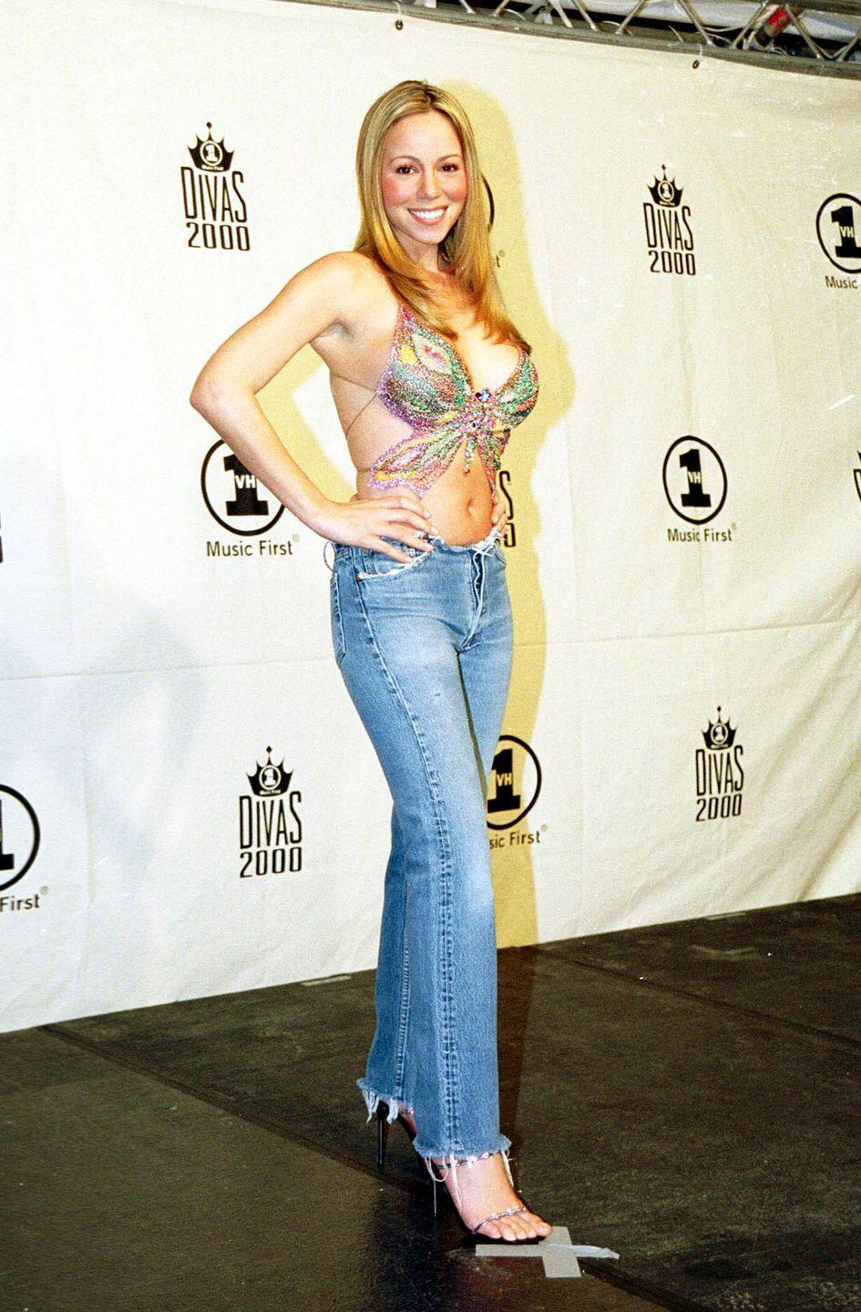 <p>Carey spread her wings at the VH1 Divas concert in a butterfly-shaped top paired with jeans that appeared to have had the waist sheared off.</p>
