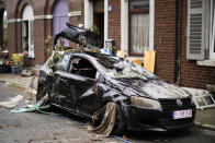 A car is strewn with debris in a residential street after flooding in Ensival, Verviers, Belgium, Friday July 16, 2021. Severe flooding in Germany and Belgium has turned streams and streets into raging torrents that have swept away cars and caused houses to collapse. (AP Photo/Francisco Seco)
