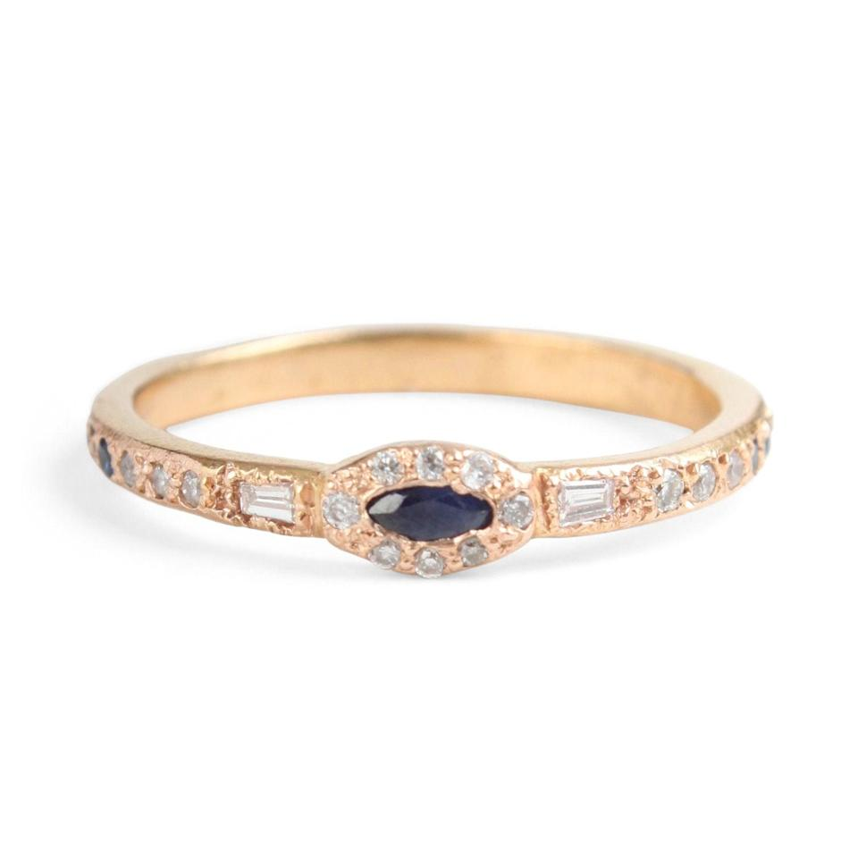 """<p>The stone on the <a href=""""https://www.popsugar.com/buy/Anastasia-Marquise-Sapphire-Ring-530027?p_name=Anastasia%20Marquise%20Sapphire%20Ring&retailer=catbirdnyc.com&pid=530027&price=1%2C750&evar1=fab%3Aus&evar9=44555978&evar98=https%3A%2F%2Fwww.popsugar.com%2Fphoto-gallery%2F44555978%2Fimage%2F47001600%2FAnastasia-Marquise-Sapphire-Ring&list1=wedding%2Cjewelry%2Crose%20gold%2Cengagement%20rings&prop13=api&pdata=1"""" rel=""""nofollow noopener"""" class=""""link rapid-noclick-resp"""" target=""""_blank"""" data-ylk=""""slk:Anastasia Marquise Sapphire Ring"""">Anastasia Marquise Sapphire Ring</a> ($1,750) may look black, but it's actually a dark blue.</p>"""