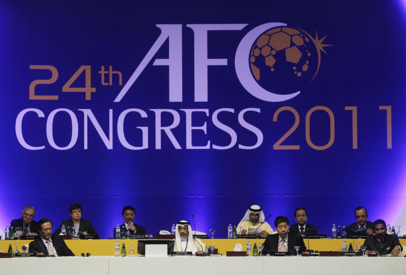 AFC President Mohamed Bin Hammam S. Al-Abdulla, second left front row, with other committee members attend the 24th AFC Congress, in Doha, Qatar, Thursday, Jan. 6, 2011. AFC Asian Cup soccer match will kick off on Jan. 7.  (AP Photo/Kin Cheung)
