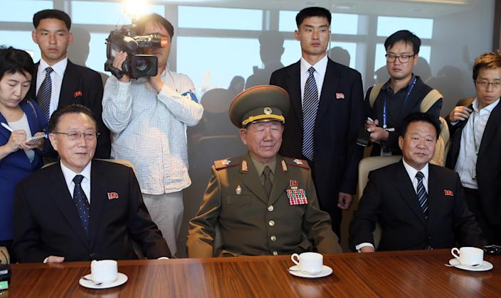 Visiting North Korean officials (from L) Kim Yang-Gon, Hwang Pyong-So and Choe Ryong-Hae, attend at meeting with South Korean Unification Minister Ryoo Kihl-Jae, at a hotel in Incheon, west of Seoul, on October 4, 2014 (AFP Photo/-)