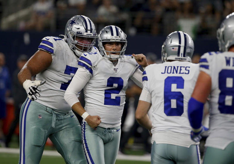 Dallas Cowboys' La'el Collins (71), from left, Brett Maher (2) and Chris Jones (6) celebrate a 63-yard field goal kicked by Maher in the first half of an NFL football game against the Philadelphia Eagles in Arlington, Texas, Sunday, Oct. 20, 2019. (AP Photo/Ron Jenkins)