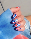 """<p>Join in on the most playful trend of the summer by splashing red, white, and blue polish onto your nails for a pop of color.</p><p><em>Watch the <a href=""""https://www.youtube.com/watch?v=o1dQ2T8CzNU"""" rel=""""nofollow noopener"""" target=""""_blank"""" data-ylk=""""slk:YouTube tutorial"""" class=""""link rapid-noclick-resp"""">YouTube tutorial</a>.</em></p>"""