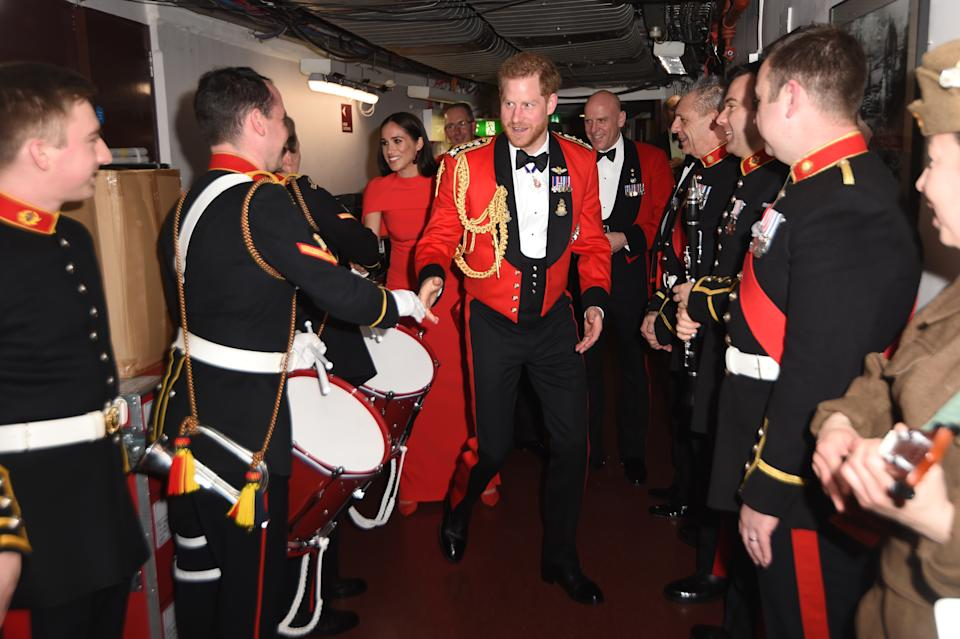 LONDON, ENGLAND - MARCH 07: Prince Harry, Duke of Sussex and Meghan, Duchess of Sussex meet band members as they attend the Mountbatten Music Festival at the Royal Albert Hall on March 7, 2020 in London, England. (Photo by Eddie Mulholland-WPA Pool/Getty Images)