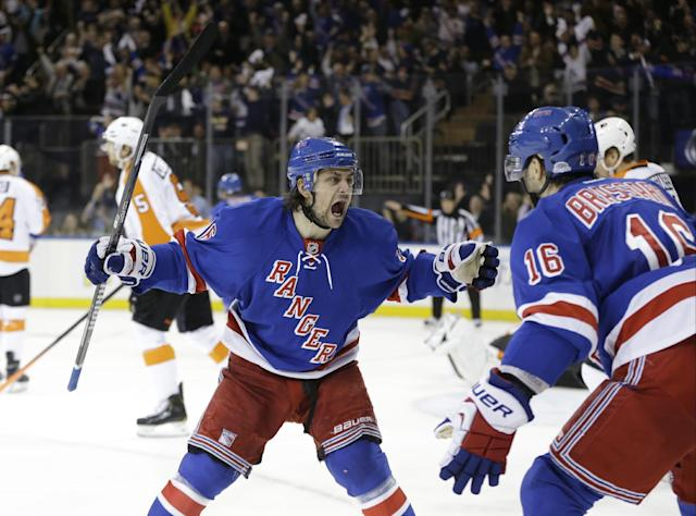 New York Rangers' Mats Zuccarello (36) and Derick Brassard (16) celebrate a goal by Benoit Pouliot during the second period in Game 7 of an NHL hockey first-round playoff series against the Philadelphia Flyers, Wednesday, April 30, 2014, in New York. (AP Photo)