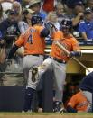 Houston Astros' George Springer is congratulated by Alex Bregman after hitting a home run during the 10th inning of a baseball game against the Milwaukee Brewers Monday, Sept. 2, 2019, in Milwaukee. (AP Photo/Morry Gash)