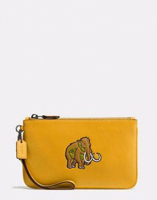 "<div>'Beasts' small wristlet bag - <a rel=""nofollow"" href=""http://uk.coach.com/coach-beasts-small-wristlet-in-glovetanned-leather/55716.html?dwvar_color=DKFLX"">£140</a></div>"