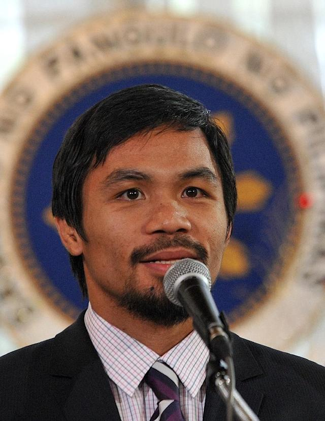 Philippine boxer Manny Pacquiao confirmed his presidential ambitions to AFP in 2013, but has since been coy about his political plans (AFP Photo/Noel Celis)