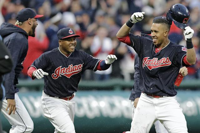 Michael Brantley (right) celebrating his walk-off double on Tuesday night. (AP)