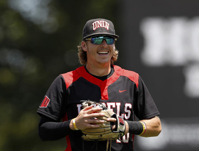 FILE - In this Sunday, May 5, 2019, file photo, UNLV's Bryson Stott (10) smiles prior to an NCAA college baseball game against the University of Houston, in Houston. Stott is ready to follow in the footsteps of superstars Kris Bryant and Bryce Harper, as the next major-league hit from southern Nevada. The UNLV junior is projected to go in the first round of June's MLB Draft, and it's the All-American candidate shortstop's humility that might be his most impressive trait. (AP Photo/Aaron M. Sprecher, File)